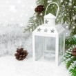 Stock Photo: Burning lantern, spruce branches with cones and Christmas tinsel