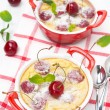 Stock Photo: Clafoutis with cherries in ramekin, top view