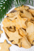 Christmas cookies in the form of stars in the bowl, top view — Stock Photo