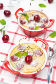 Clafoutis with cherries in ramekin, top view — Stock Photo