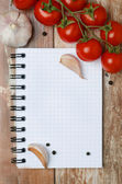 Fresh tomatoes and spices on a wooden background paper for notes — Stock Photo
