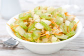 Salad with celery, carrots and apples closeup — Stock Photo