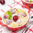 Stock Photo: Casserole (clafoutis) with cherry in ramekin, top view