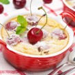 Clafoutis with cherries in red ramekin, close-up — Stock Photo