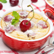 Stock Photo: Clafoutis with cherries in red ramekin, close-up