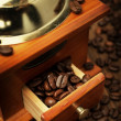 Old coffee grinder and coffee beans, close-up — Stock Photo #30146901