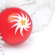 Red Christmas ball and decoration on white background — Stock Photo