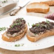 Toast with liver pate and caramelized red onion — Stock Photo
