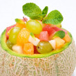 Fruit salad in melon close-up, horizontal — Stock Photo #30819863