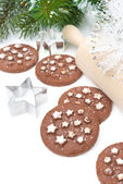 Christmas chocolate cookies, baking dish and rolling pin — Stock Photo