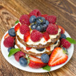 Pancake cake with whipped cream and fresh berries — Stock Photo
