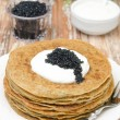 potato pancakes with sour cream and caviar on a plate — Stock Photo