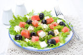 Salad with watermelon, feta cheese and olives — Stock Photo