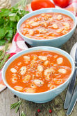Tomato soup with pasta, white beans and rosemary — Stock Photo