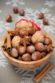 Wooden bowl with nuts and spices — Stockfoto