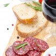 Antipasto - salami, bread, olives and glass of red wine isolated — Stock Photo