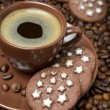 Cup of coffee and Christmas cookies on the coffee beans — Stock Photo