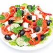 Greek salad with fetcheese, olives and vegetables, top view — Stock Photo #31142121