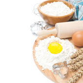 Baking ingredients - flour, egg and baking forms, isolated — Stock Photo
