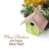 Christmas composition with fir branches, decorations, birdhouse — Stock Photo