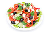 Greek salad with feta cheese, olives and vegetables, top view — Stock Photo