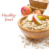 Healthy breakfast - oat flakes with apples in a bowl — Stock Photo