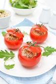 Tomatoes stuffed with tuna salad and bulgur — Stock Photo