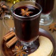 Christmas mulled wine with spices in glass and cookies — Foto de Stock   #32009553