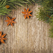 Christmas frame (spruce branches and star anise) on the old wood — Stock Photo #32009725