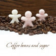 Sugar in form of little men on coffee beans, isolated — Stock Photo #32011417