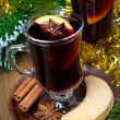 Two glasses of mulled wine with spices in glass and cookies — Stock Photo #32011669