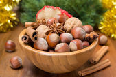 Wooden bowl with nuts and spices for Christmas, selective focus — Stock Photo