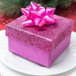 Stock Photo: Pink gift box on plate for Christmas