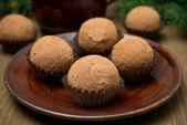 Chocolate truffles on the plate — Stock Photo
