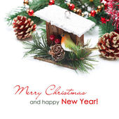 Christmas decorations - birdhouse, spruce branches and tinsel — Stock Photo