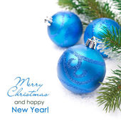 Composition with blue Christmas balls and spruce branches — Stock Photo