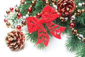 Composition with Christmas ornaments on the branches of spruce — Stock Photo