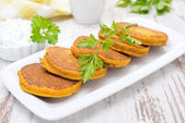 Pumpkin fritters with herbs — Stock Photo