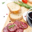 Antipasto - salami, bread, olives and glass of wine isolated — Stock Photo