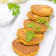 Pumpkin fritters with herbs, top view — Stock Photo