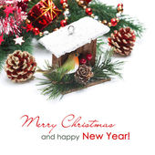 Christmas decorations - birdhouse, spruce branches — Stock Photo