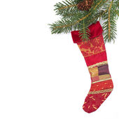 Fir branches and red stocking for gifts, isolated — Stock Photo