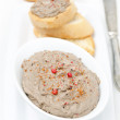 Liver pate with pink pepper in a white bowl — Stock Photo #33906005