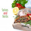 Spices and fresh herbs on a wooden tray, isolated on white — Stock Photo