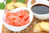 Asian ingredients fresh and pickled ginger, soy sauce and sesame — Stock Photo