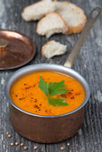 Spicy red lentil soup in a copper saucepan — Stock Photo