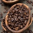 Coffee beans in a wooden bowls, top view — Stock Photo