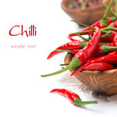 Bowl with fresh chili peppers, selective focus, isolated — Stock Photo