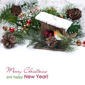 Composition with Christmas decorations - birdhouse, fir branches — Stock Photo