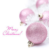 Composition with pink Christmas balls and tinsel, isolated — Stock Photo